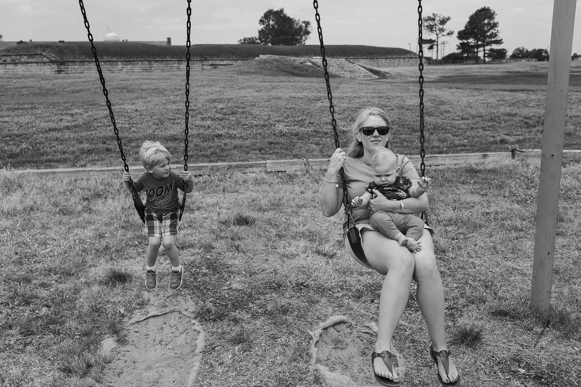 mother children swinging