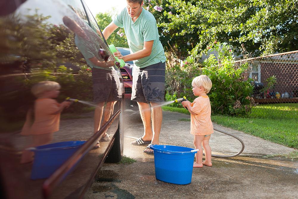 son helping dad wash car