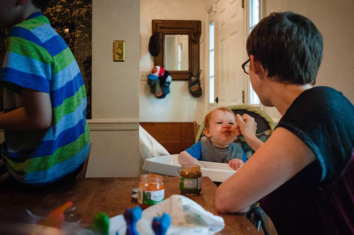Mom feeding baby son
