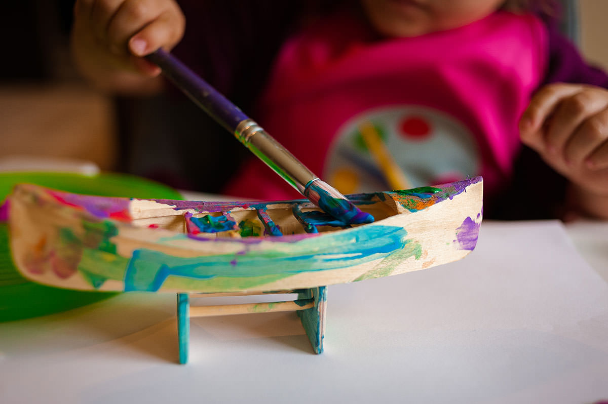 painting boat with paintbrush