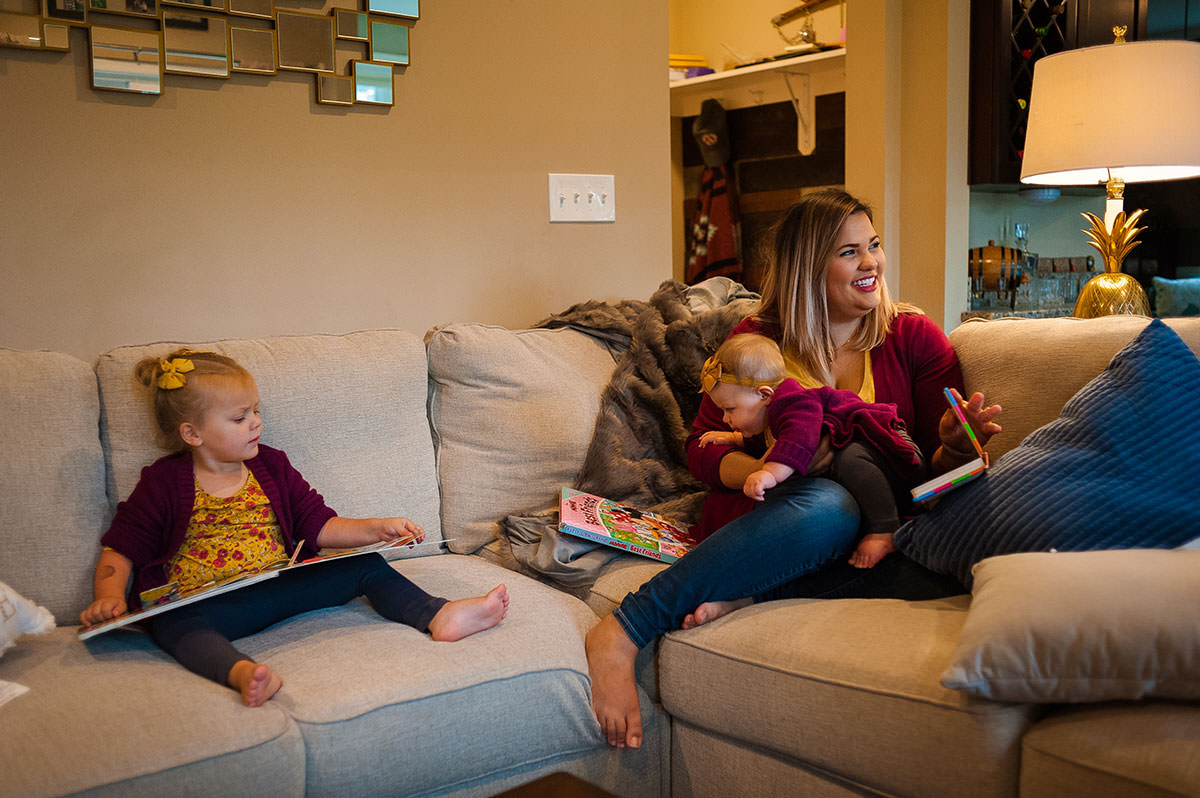 girls sitting and reading on couch