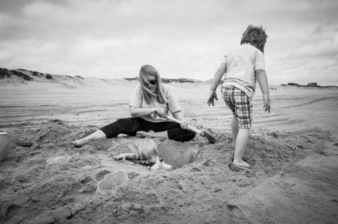 Dreama digging in the sand with Colby and Caroline