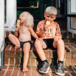 kids sitting on steps eating ice cream